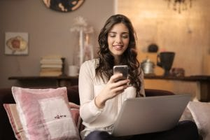girl shopping online on couch
